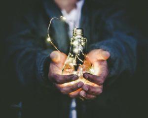 visualise man holding light bulb