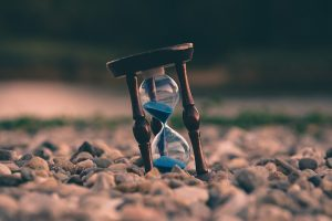hourglass on ground